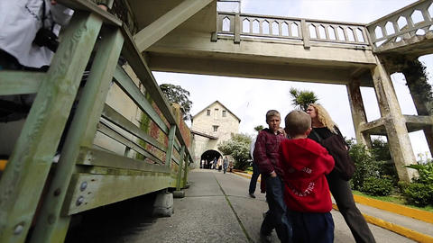 2 angles - tourist walk past Alcatraz watch tower Footage