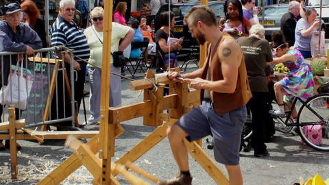 People watching spring pole lathe demonstration 2 Footage