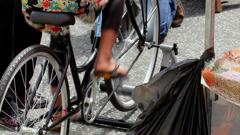 Girl Peddling On A Stationery Bicycle stock footage