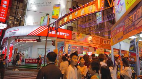 many people waiting at fenjia night market entranc Stock Video Footage