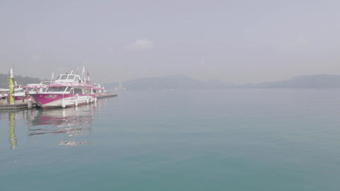 a high to low tilt of some boats and the emerald s Stock Video Footage