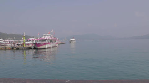 dolly shot - boats at the sun moon lake pier Stock Video Footage