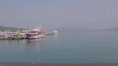 dolly shot - boats at the sun moon lake pier Footage