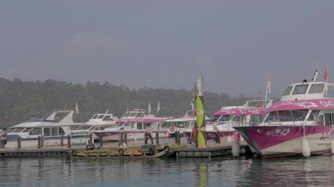 close shot sun moon lake - people boarding boat at Footage