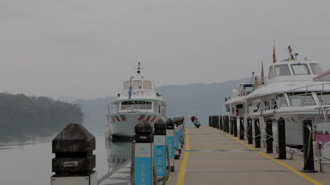 dolly pan of boats and sun moon lake Stock Video Footage