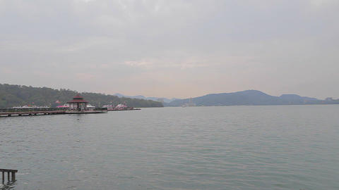 ita thao pier at sun moon lake with mountains Stock Video Footage