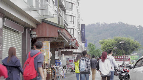 friends walking through town of ita thao Stock Video Footage