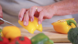Woman slicing a peppper Stock Video Footage