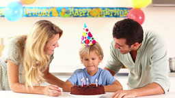 Family blowing birthday candles Stock Video Footage
