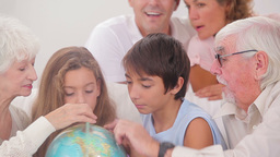 Extended family looking at globe Footage