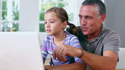 Grandfather and girl using laptop Footage