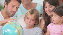 Happy family looking at globe Footage