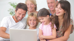 Smiling family watching something on laptop Stock Video Footage