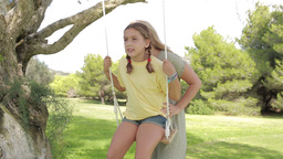 Mother pushing daughter on the swing Stock Video Footage