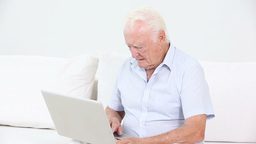 Old man using a laptop Footage