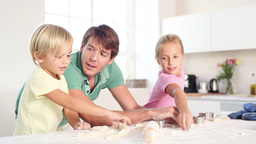 Father and his children kneading a dough Stock Video Footage