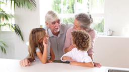 Little children chatting with grandparents Stock Video Footage