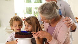 Grands parents and children making chocolate sauce Stock Video Footage