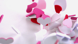 Pink heart confetti dropping on the floor Stock Video Footage