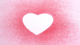 Little pink confetti falling on a heart draw Stock Video Footage