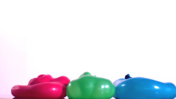 Three bouncing water balloons Footage