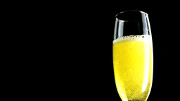 Flute of champagne settling Stock Video Footage