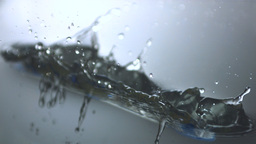 Blue toothbrush dropping in water Stock Video Footage
