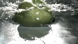 Green apple falling in water Stock Video Footage