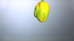 Green chili falling in water close up Stock Video Footage