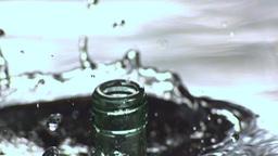 Glass bottle falling in water Footage