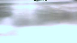Upside down glass bottle falling in water Stock Video Footage