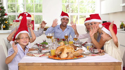 Family around the dinner table at christmas Stock Video Footage