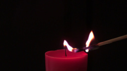 Pink candle lit by match Live Action