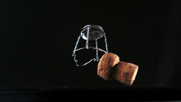 Champagne cork falling and bouncing Stock Video Footage