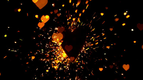 Golden confetti and sparks flying against heart Footage