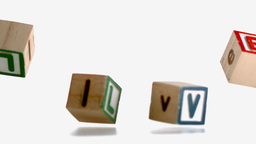 Wooden blocks spelling out love falling Stock Video Footage