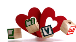 Building blocks spelling out love falling with hea Stock Video Footage