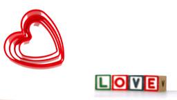 Heart ornaments falling in slow motion Stock Video Footage