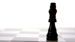 White chess piece knocking over black Stock Video Footage