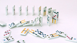 White dominoes falling over Footage