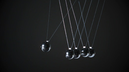 Newtons cradle on black background Footage