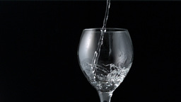 Water pouring into wine glass Live Action