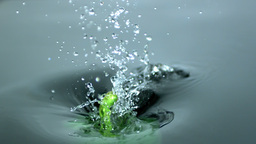Green pepper falling into water Stock Video Footage