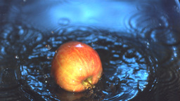 Apple falling into water Stock Video Footage
