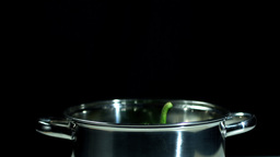 Green pepper falling into pot Footage