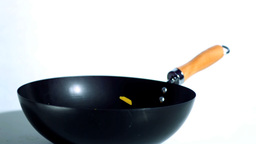 Sliced yellow pepper falling into wok Footage