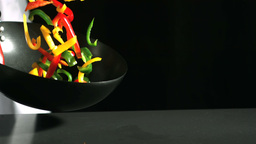 Chef tossing wok of peppers Stock Video Footage