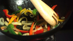 Wooden fork mixing vegetables in wok Stock Video Footage
