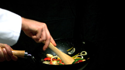 Chef stirring vegetables in wok Footage