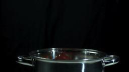 Jalapeno chili falling into a pot Footage